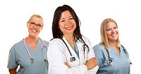 Hispanic Female Doctor and Colleagues Behind