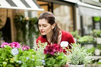 Woman smelling flowers in a flower shop (thumbnail)