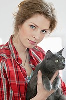 Woman holding a black cat (thumbnail)