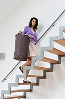 Woman carrying a laundry basket