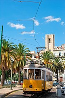 beautiful city sight of the capital of Portugal with yellow typical tram