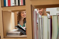 Couple choosing books from a bookshelf