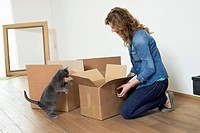 Woman looking at her cat standing on hind legs