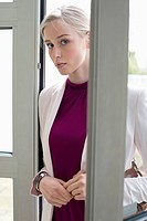 Businesswoman entering home (thumbnail)
