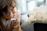 Close_up of a boy looking at a dog