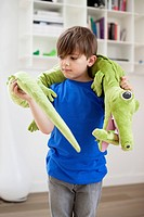 Boy playing with animals toys (thumbnail)