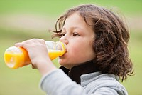 Close_up of a boy drinking juice