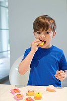 Boy eating a cup cake