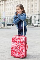 Girl standing with her luggage