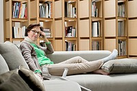 Woman resting on a couch (thumbnail)