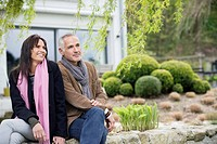 Romantic couple sitting in a garden