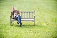 Man sitting on a bench and thinking in a park (thumbnail)