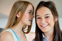 Girl whispering to her friend (thumbnail)