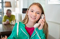 Portrait of a girl talking on a phone and smiling
