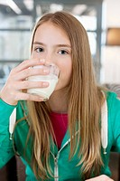 Portrait of a girl drinking milk