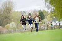 Happy family running in a field (thumbnail)