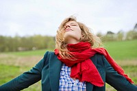 Beautiful woman daydreaming in a field (thumbnail)