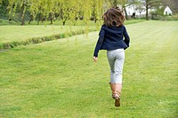 Girl running in a field