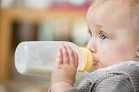 Close_up of a baby girl feeding milk