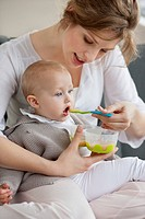 Woman feeding her daughter (thumbnail)