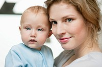 Close_up of a woman with her baby girl