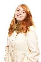 young happy redhead woman in fawn winter coat