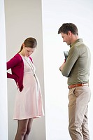 Man looking at a pregnant woman