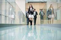 Business executives walking in a corridor