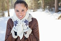Portrait of smiling woman in snowy woods