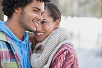 Close up portrait of couple hugging outdoors