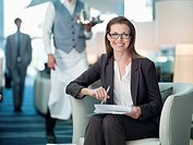 Portrait of smiling businesswoman working in hotel lounge