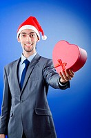 Businessman offering gifts on christmas