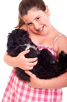 adorable little girl holding her dog isolated on white background