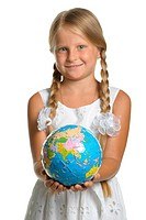 The girl holds the globe collected from puzzle in hands. Selecti