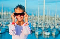 Portrait of a girl in the background of yachts