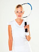 Portrait of a young female tennis player with her racquet over her shoulder