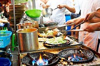 Preparing food at a busy Thai restaurant