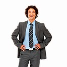 Confident young businessman with his arms akimbo _ Isolated on white