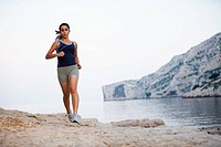 France, Marseille, Woman jogging by seaside