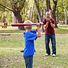 Father And Son Playing Baseball In A Park, Edmonton Alberta Canada