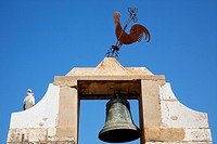 A Bird And Metal Rooster Sit Atop A Bell Tower, Faro Algarve Portugal