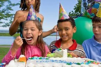 Children eating birthday cake