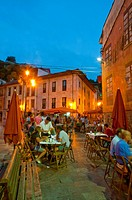 Terraces in the old town, night view. Ribadesella, Asturias province, Spain
