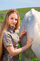 portraite of attractive girl and horse. outdoor shot