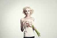 Young woman holding bunch of gerbera daisies
