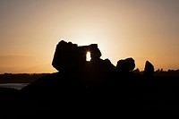 Sunlight Shining Through A Hole In A Rock Formation At Sunset, Clonmacnoise County Offaly Ireland