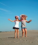 two little girl jumping