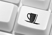 The button with an emblem of a cup of coffee on the keyboard. A working break