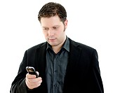 Portrait of a handsome young business man using mobile phone. Isolated on white background with copy space.