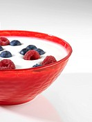 Yoghurt bowl with raspberries and blueberries